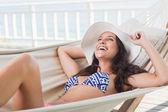 Pretty brunette relaxing on a hammock — Stock Photo