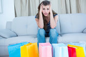 Woman looking at many shopping bags — Stock Photo