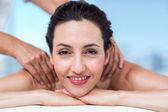 Smiling brunette getting back massage — Stock Photo