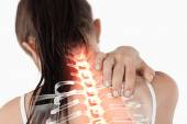 Highlighted spine of woman with neck pain — Stock Photo