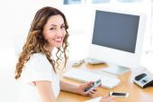 Smiling businesswoman looking at camera — Stock Photo