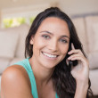 Pretty brunette calling with her mobile phone — Stock Photo #73432609
