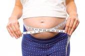 Pregnant woman measuring her bump — Stock Photo