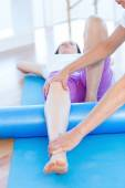 Trainer working with woman on exercise mat  — Stock Photo
