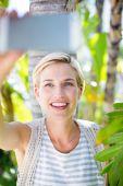 Blonde woman taking selfie — Stock Photo