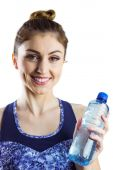 Fit brunette holding water bottle — Stock Photo