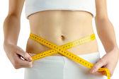 Slim woman measuring her waist — Stock Photo