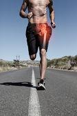 Highlighted hip bone of running man — Stock Photo