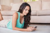 Pretty brunette texting with her smartphone  — Stock Photo