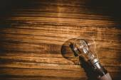 Light bulb on wooden table — Stock Photo