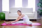 Fit woman doing yoga on mat — Stock Photo