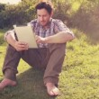Young man using tablet in the countryside — Stock Video #73498323