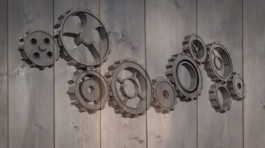 Cogs and wheels turning on wooden background — Vidéo