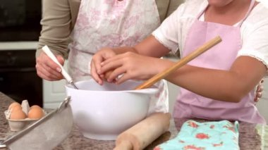 Mother and daughter making cake together — Stock Video