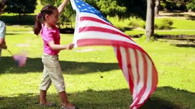 Little siblings with american flag — Stock Video