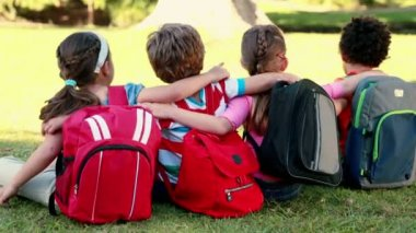 School children sitting on grass — Stock Video