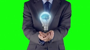 Businessman presenting light bulb with hands — Stockvideo