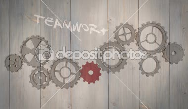 Cogs and wheels turning on wooden background — Stockvideo