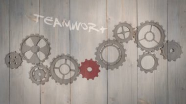 Cogs and wheels turning on wooden background — 图库视频影像