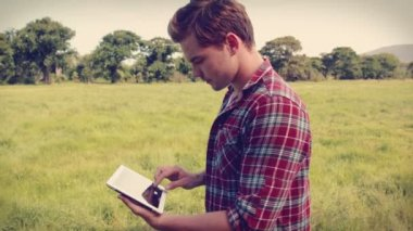 Handsome hipster using tablet — Stock Video