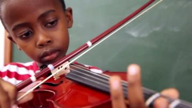 Cute pupil playing violin — Stock Video