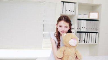 Doctor examining a teddy bear — Stock Video