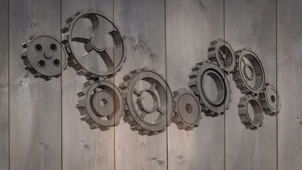 Cogs and wheels turning on wooden background — Vídeo de stock