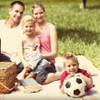 Parents and children relaxing at a picnic — Stock Photo #76125043