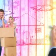 Composite image of attractive young couple leaning on boxes with — Stock Photo #76125061