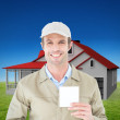 Happy delivery man showing blank note — Stock Photo #76125653