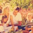 Family playing together in a picnic — Stock Photo #76126427