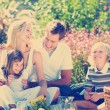 Family playing together in a picnic — Stock Photo #76128625