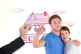 Composite image of couple holding keys to home — Stock Photo