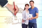 Composite image of couple holding a white piggy bank — Stock Photo