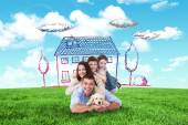 Composite image of happy family lying on top of each other with — Stock Photo