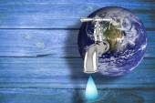 Composite image of earth with faucet — Stock Photo