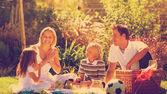 Happy family having a picnic — Stock Photo