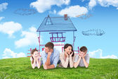 Composite image of family lying with head in hands — Stock Photo
