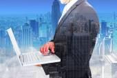 Immagine composita dell'uomo d'affari che tiene computer portatile — Foto Stock
