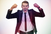 Furious businessman tensing arms muscle — Stock Photo