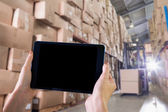 Composite image of finger pointing to tablet — Stock Photo