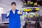 Happy mechanic holding spanner — Stock Photo