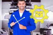 Male mechanic holding lug wrench — Stock Photo
