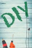 Diy contra ferramentas em fundo de madeira — Fotografia Stock