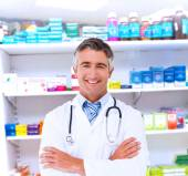 Happy doctor smiling at camera — Stock Photo