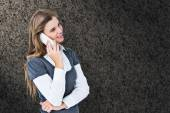 Composite image of happy blonde on the phone — Stock Photo