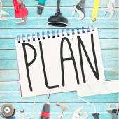 Plan against tools and notepad on wooden background — Stock Photo