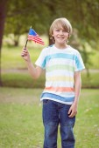 Boy holding an american flag — Stock Photo
