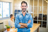 Smiling man standing arms crossed with his partner — Stock Photo