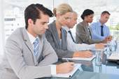 Business team taking notes during conference  — Stock Photo